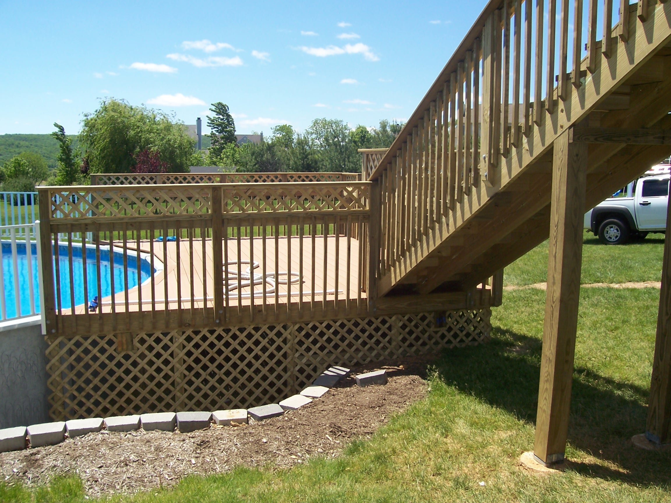 home improvement swimming pool deck with pole stairs