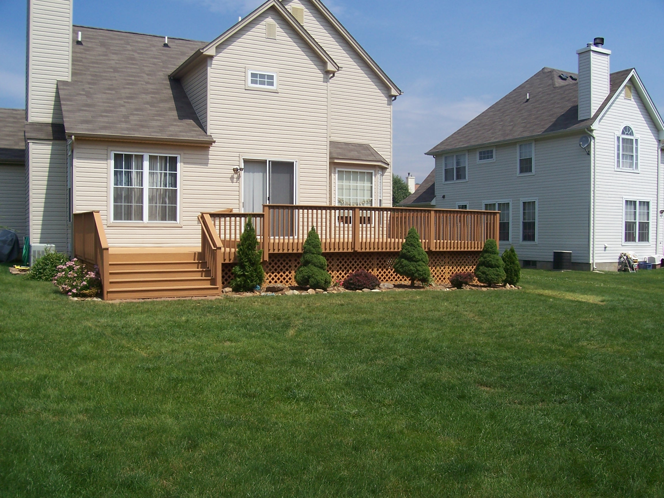 home improvement rear deck with stairs