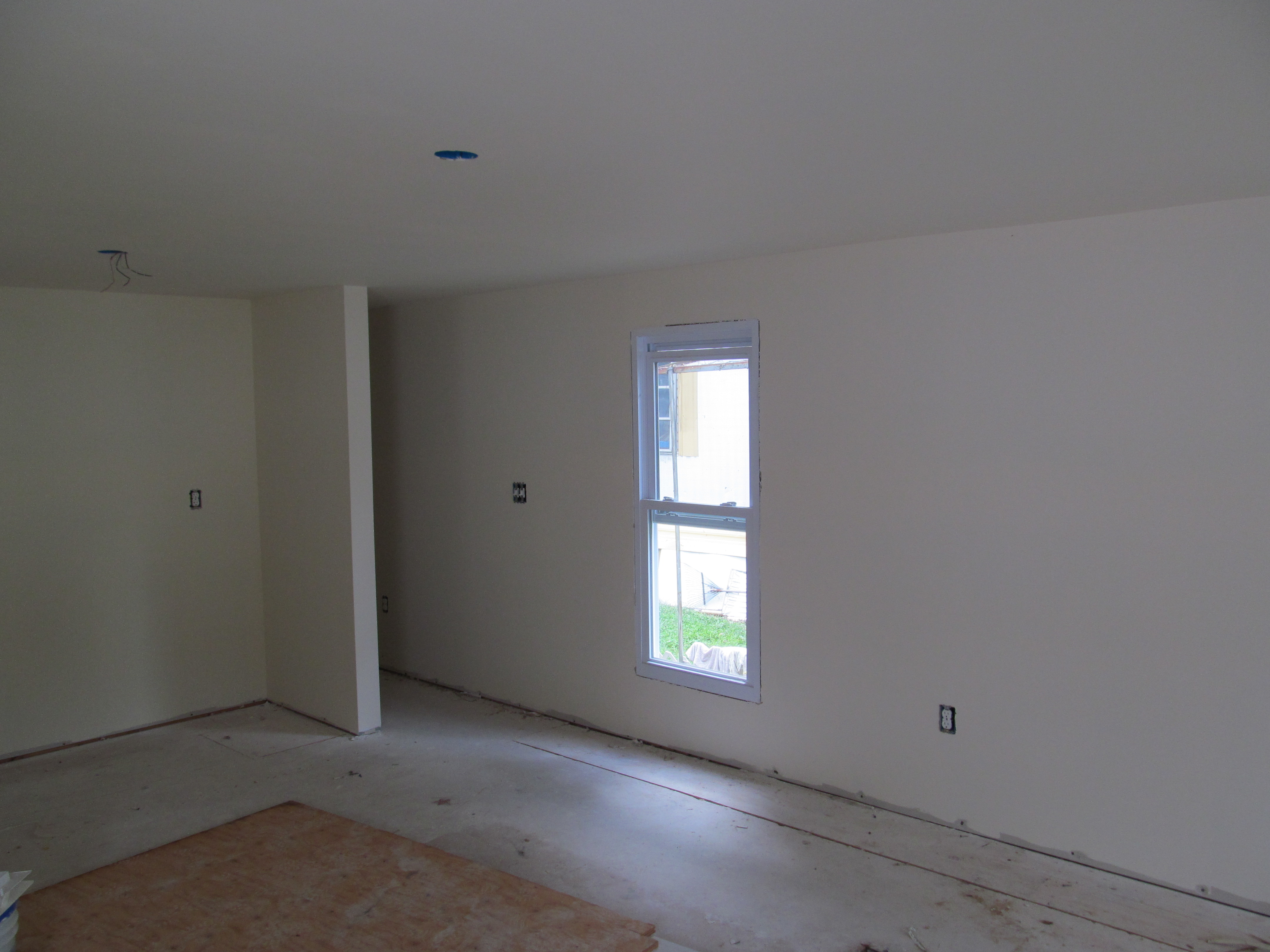 mobile home improvement front room with hallway and window