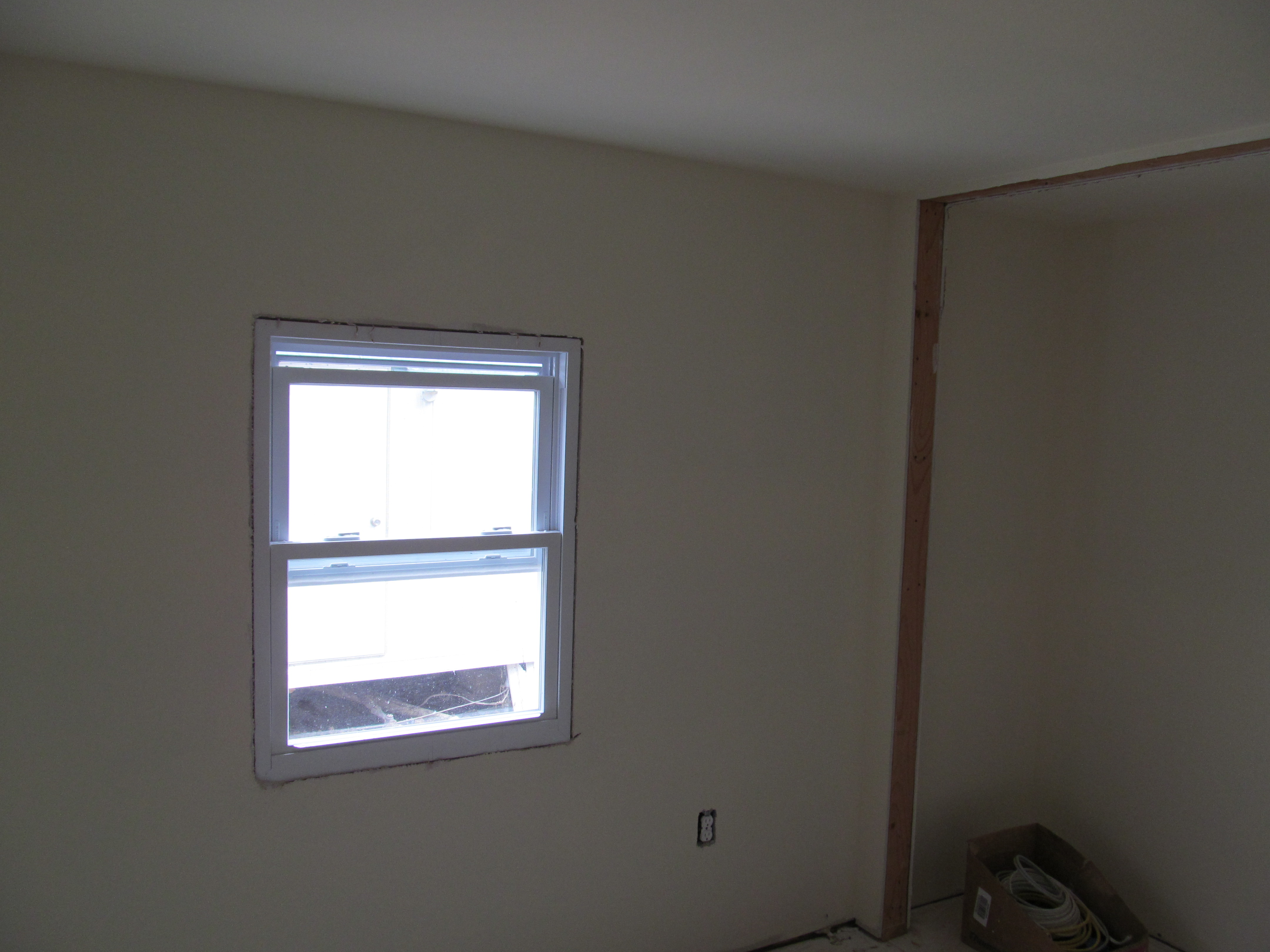 mobile home improvement interior room with window and closet